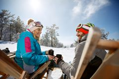 Woman and man on skiing in sunbed enjoy with drink stock photos