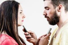 Woman man and smart phones Stock Photos