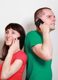 Woman and man with smile talking on mobile phone Stock Photography