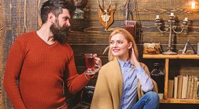 Woman and man on smiling faces enjoy cozy atmosphere with hot drinks. Coziness concept. Couple spend pleasant evening. Woman and men on smiling faces enjoy cozy stock images