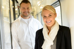Woman and man smiling standing in train Stock Photos