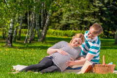Woman and a man spend their free time at the picnic Stock Photo