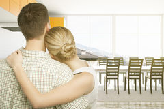 Woman and man standing in kitchen. Woman and men standing in kitchen interior with blank whiteboard and window with city view. 3D Rendering Stock Image