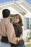 Woman With Man Standing Outside A House Royalty Free Stock Images