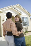 Woman With Man Standing Outside A House Stock Images