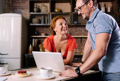 Woman and man standing over laptop Stock Photo