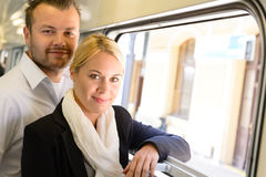 Woman and man standing by train window Royalty Free Stock Photos