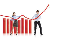 Woman and man with statistics curve Royalty Free Stock Photography