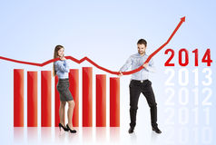 Woman and man with statistics curve Stock Images