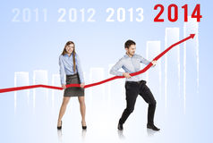 Woman and man with statistics curve Stock Photography