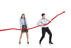Woman and man with statistics curve Stock Photos