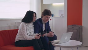 Woman and man talk remote with coworkers in apartment stock video footage
