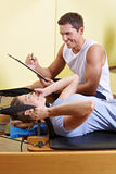 Woman and man talking in fitness Stock Image