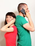 Woman and man talking on mobile phone Royalty Free Stock Image
