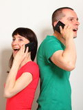 Woman and man talking on mobile phone Stock Image