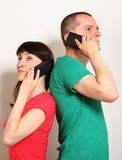 Woman and man talking on mobile phone Stock Images