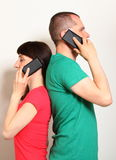 Woman and man talking on mobile phone Stock Photo