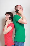 Woman and man talking on mobile phone Stock Photos