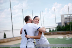 A woman and a man on the  tennis courts Royalty Free Stock Photography
