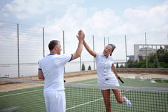 A woman and a man on the  tennis courts Stock Image