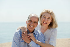 Woman with man together against sea in background Royalty Free Stock Photo