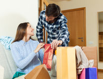 Woman and man together with clothes and bags Stock Images