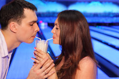 Woman and man together drink milk cocktail Royalty Free Stock Photos