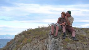 Woman and man on the top of a mountain stock video footage
