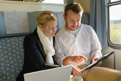 Woman and man in train laptop clipboard Royalty Free Stock Image