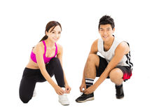 Woman and man tying sports shoes before workout Stock Image