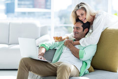 Woman and man using at home Royalty Free Stock Photos