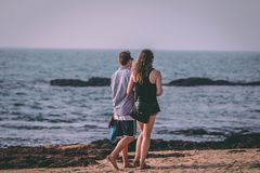 Woman and Man Walking Near Seashore Royalty Free Stock Photography