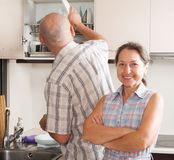 Woman and man washing dishes in the kitchen Stock Photo