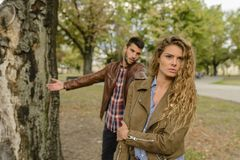 Woman And Man Wearing Brown Jackets Standing Near Tree Royalty Free Stock Image