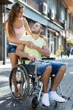 Woman and man in wheelchair Stock Images