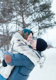 Woman and man on winter walk stock images