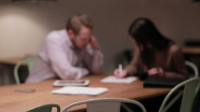 Woman and man working with documents in cafe stock footage