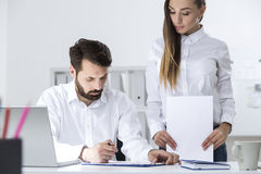 Woman and man working with documents Royalty Free Stock Photography