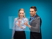 Woman and man working with forex chart. Business, technology and money concept - businesswoman and businessman working with forex chart on virtual screen Royalty Free Stock Image