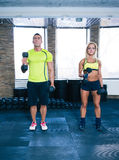 Woman and man working out with dumbbells Stock Images