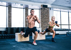 Woman and man working out at gym Royalty Free Stock Photos