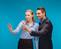 Woman and man working with virtual screen Stock Photography