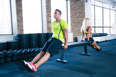 Woman and man workout with hands on bench Royalty Free Stock Photos