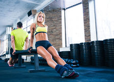 Woman and man workout with hands on bench Royalty Free Stock Image