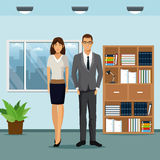 Woman and man workspace office bookshelf plant pot window Stock Photo