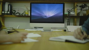 Woman and Man Writing Code For Ux on Paper. view4 stock footage
