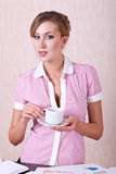 Woman manager in office with cup tea Royalty Free Stock Photos