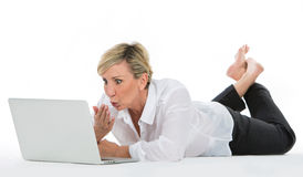 Woman manager sat on the floor with laptop Royalty Free Stock Photo