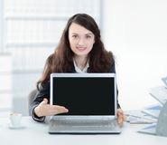 Woman Manager is showing on a laptop. Photo with copy space royalty free stock image