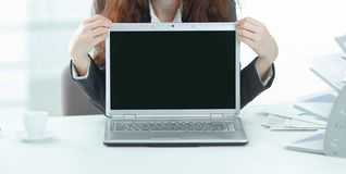 Woman Manager is showing on a laptop. Photo with copy space stock photo